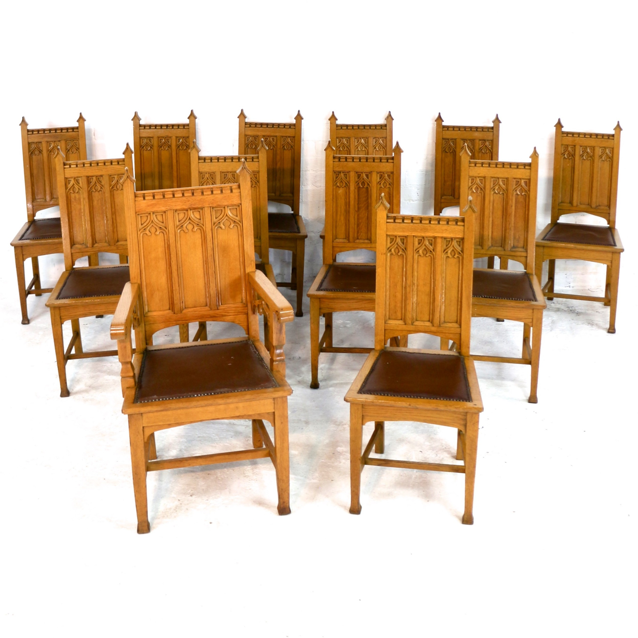 set of twelve gothic revival arts crafts oak dining chairs attributed to shapland petter 12