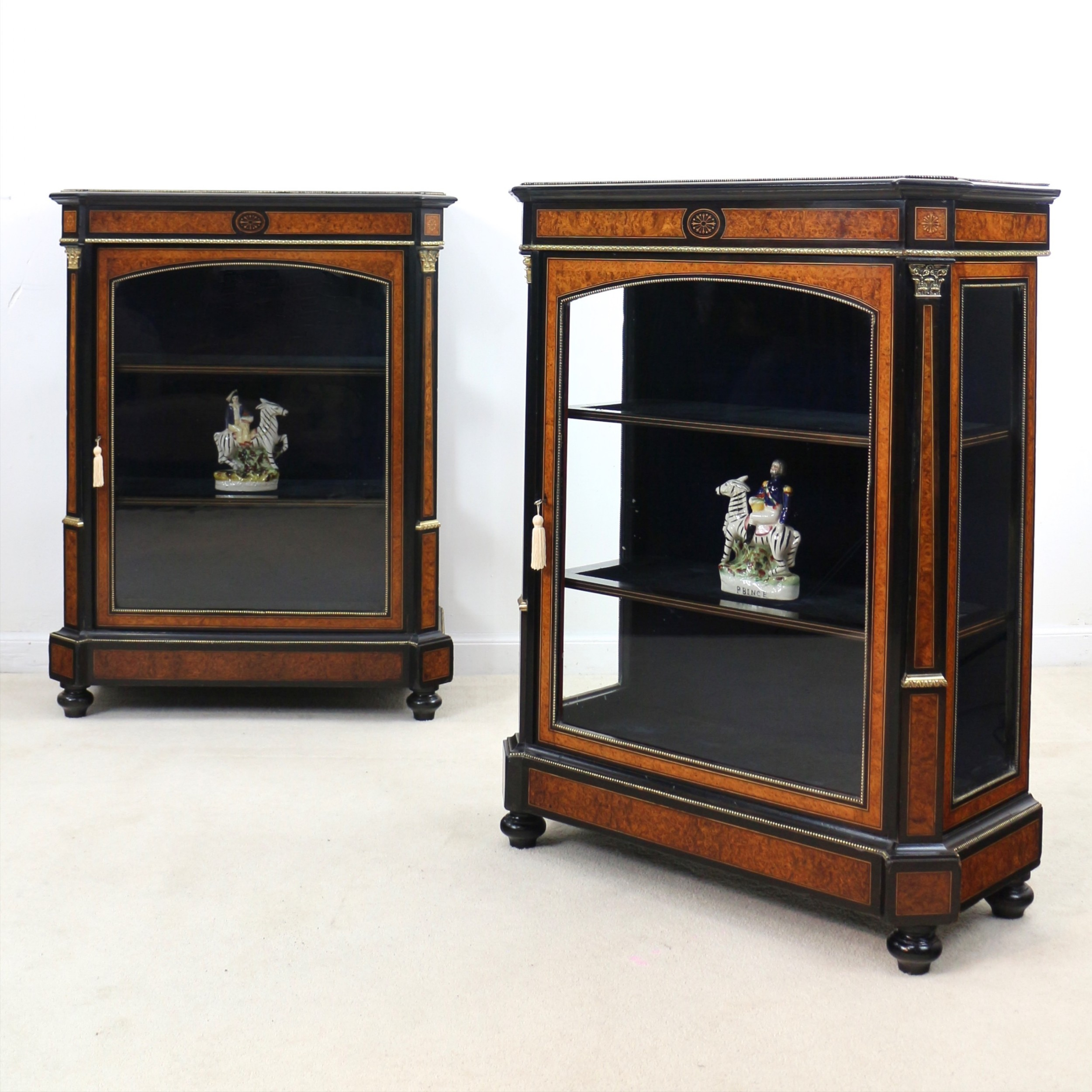 pair of victorian gilt metal mounted ebonised and amboyna inlaid pier display cabinets