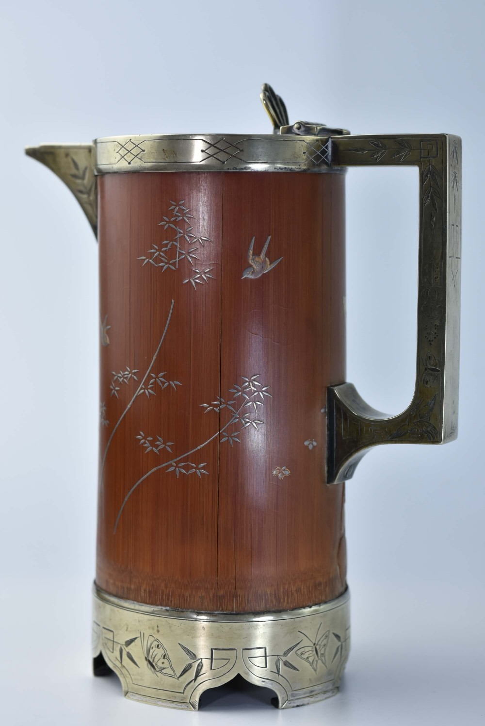 stunning aesthetic movement carvedinlaid bamboo and engraved silver plated jug