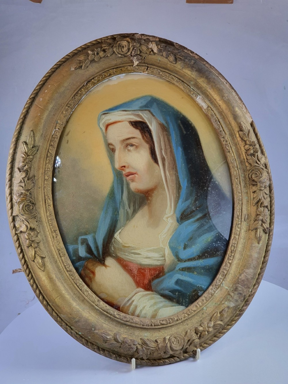 early 19th century large gilt framed oval painting under glass 'our lady of sorrow'