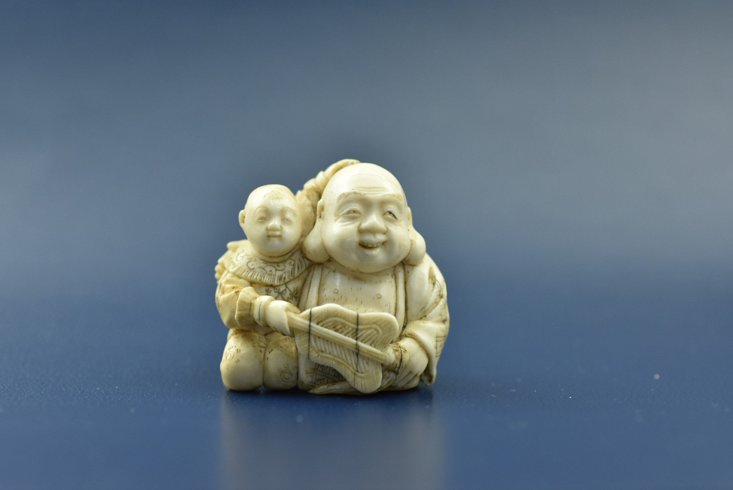 fine quality 19th century carved ivory netsuke father son