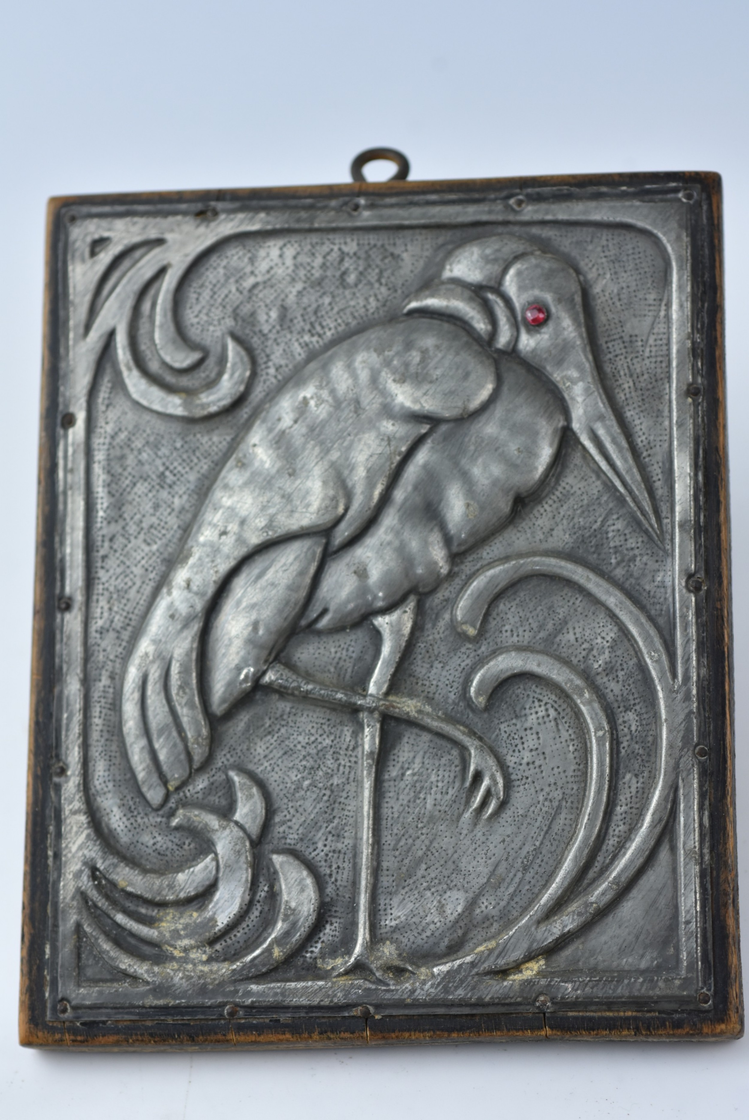 stylish aesthetic movement heron pewter plaque on wooden mount c1890
