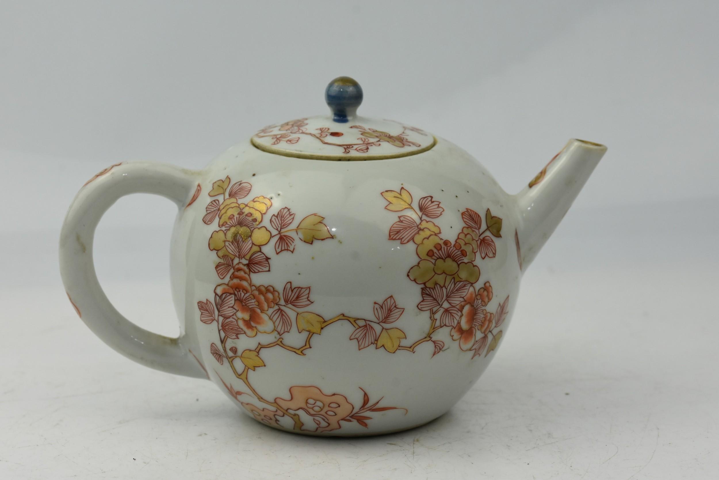 18th century rouge de fer porcelain bullet shaped teapot and cover c1700