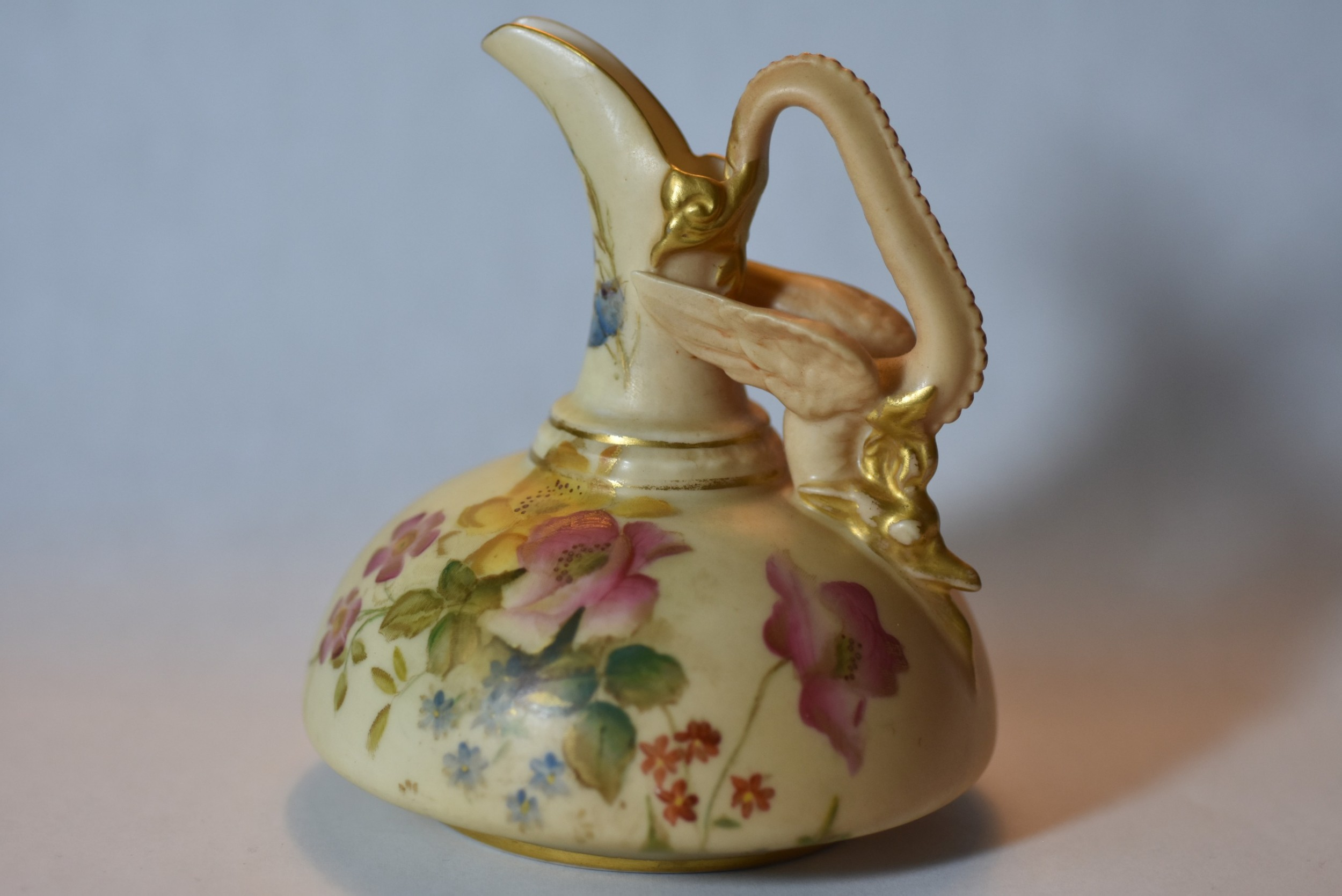 unusual royal worcester hand painted blush ivory jug with dragon handle c1906