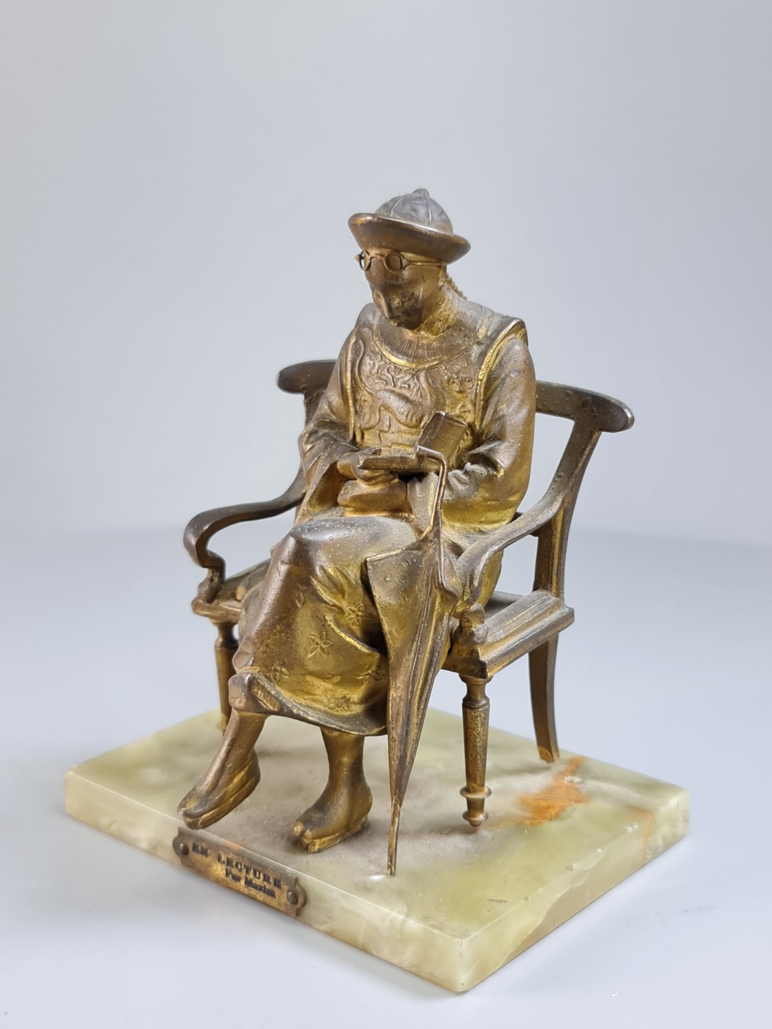 french gilt bronze seated figure 'en lecture' on onyx base c1900