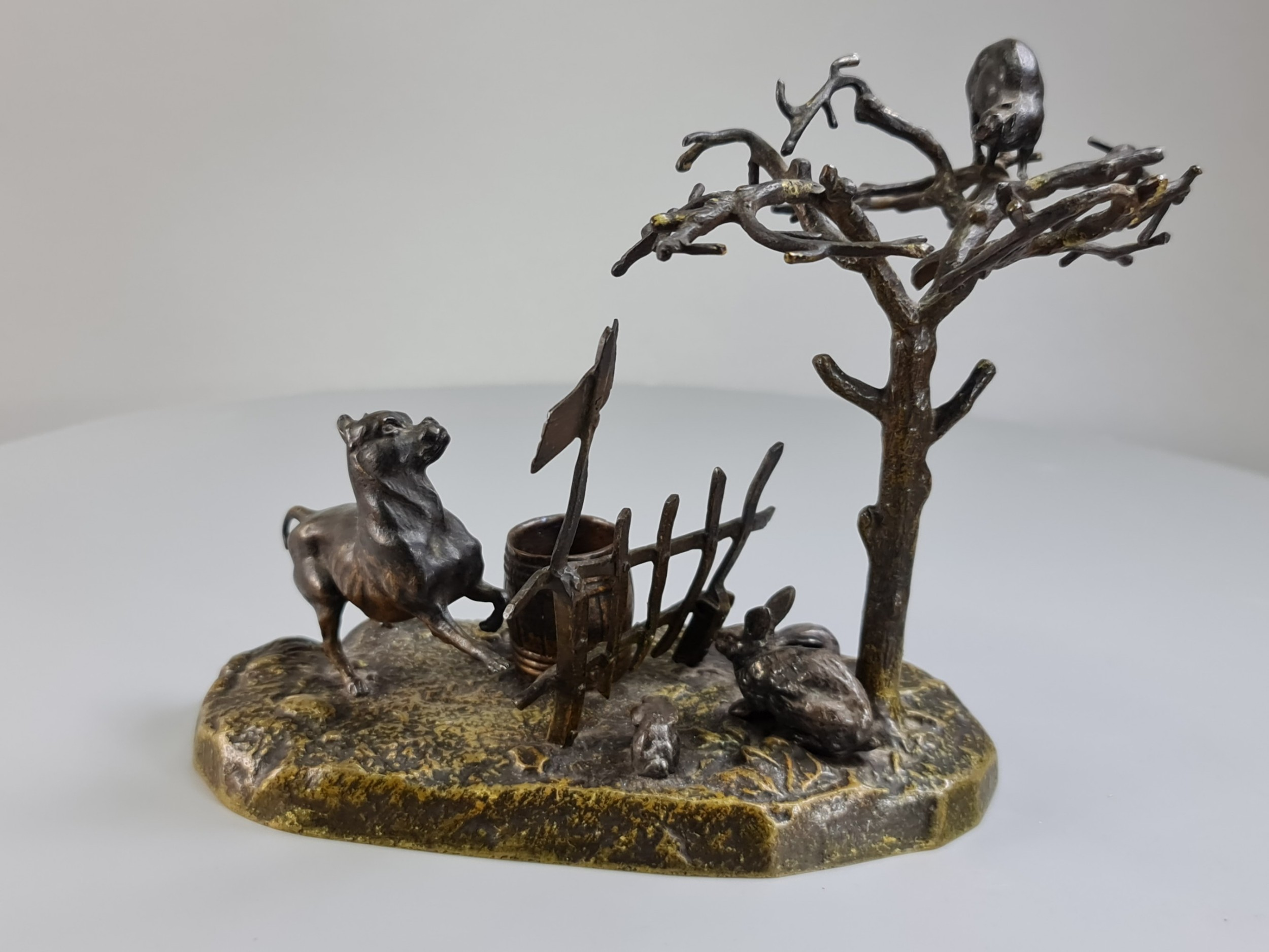 charming victorian bronze group of a dog chasing a cat up a tree c1880