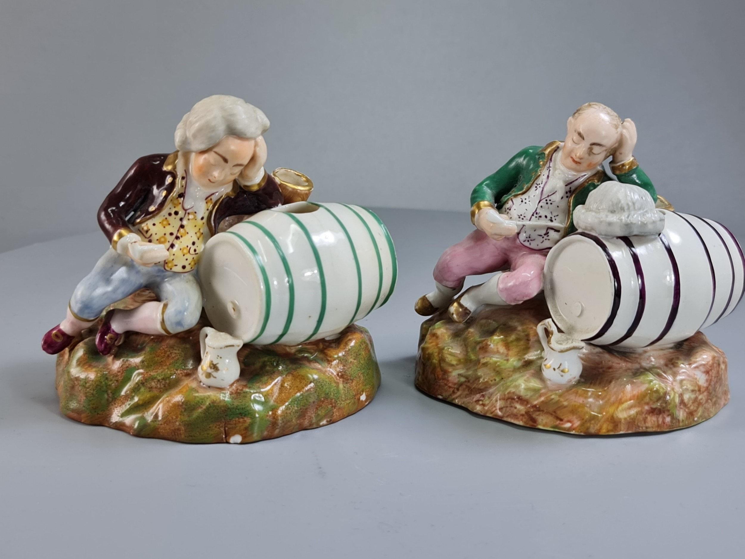 unusual early 19thc pair of porcelain inkwells formed as barrels figures by dudson