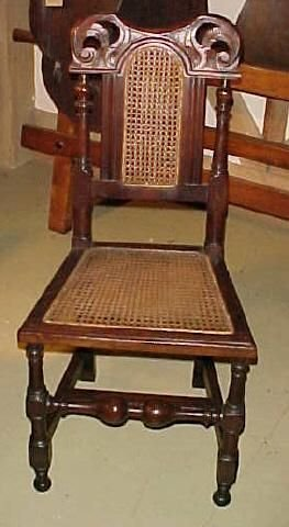 one of 12 victorian well carved walnut dining chairs with caned seats