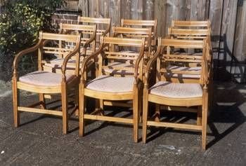 a set of nine dining chairs with well shaped and decorated backs having drop in upholstered seats
