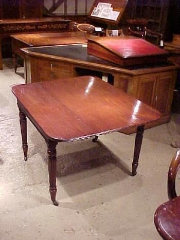 a victorian mahogany side table which extends to a small dining table