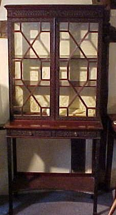 a victorian mahogany 'chippendale style' showcase cabinet