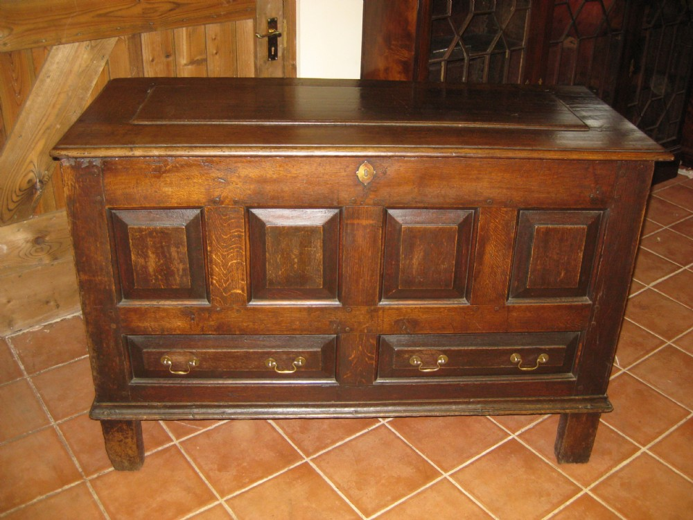 an early georgian oak raised panelled mule chest