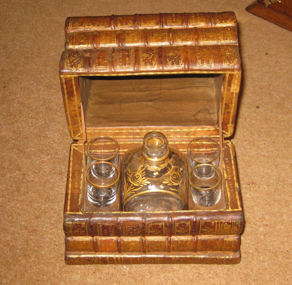 a wonderful french book box 1904 containing a lovely decanter and 4 'shot' glasses