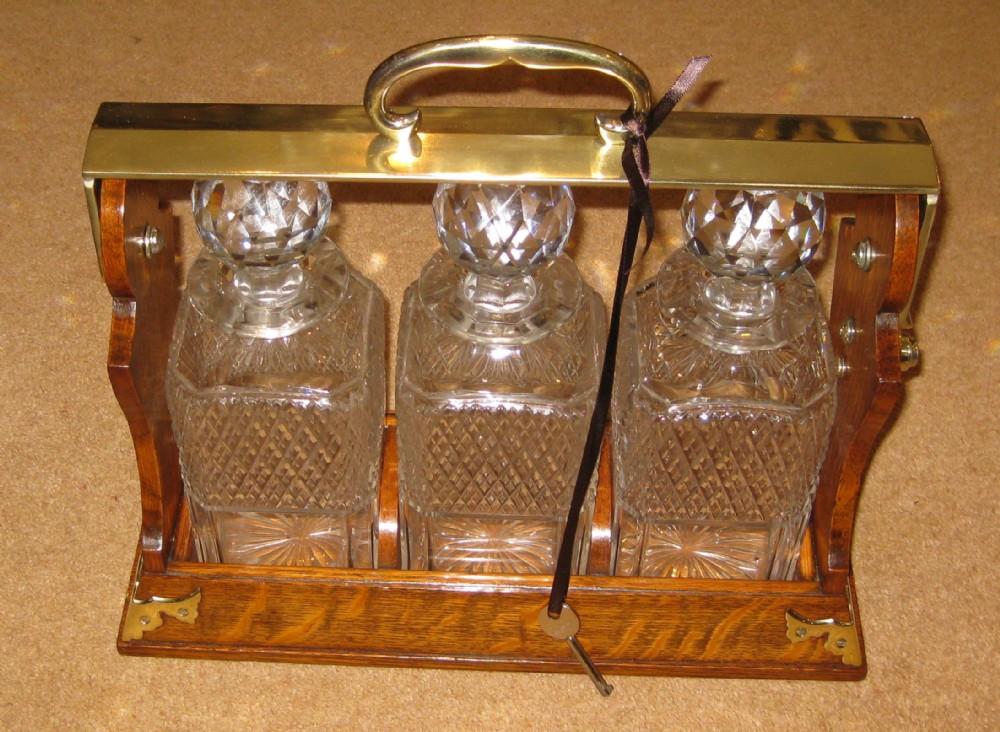 a circa 1890 three decanter tantalus by betjemann