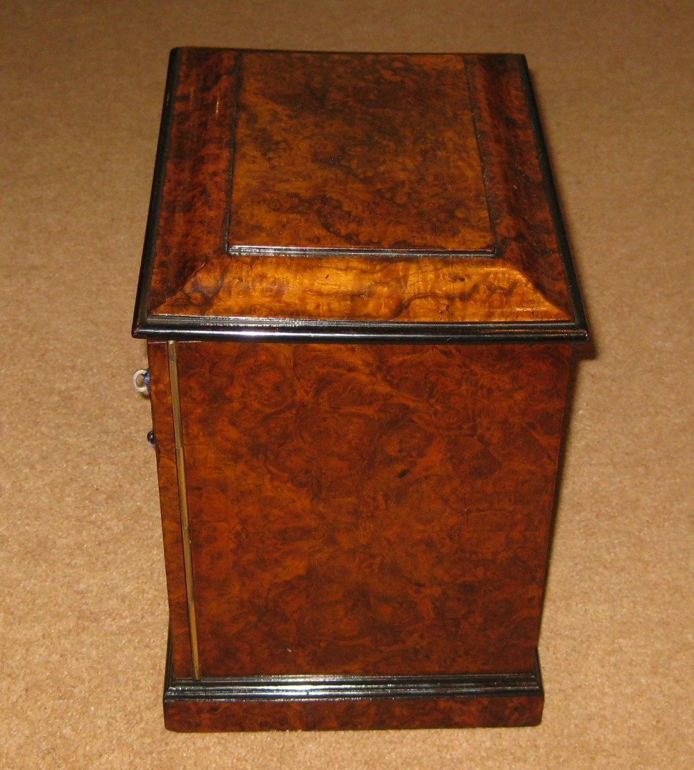 a superb burr walnut jewellery cabinet by gillows