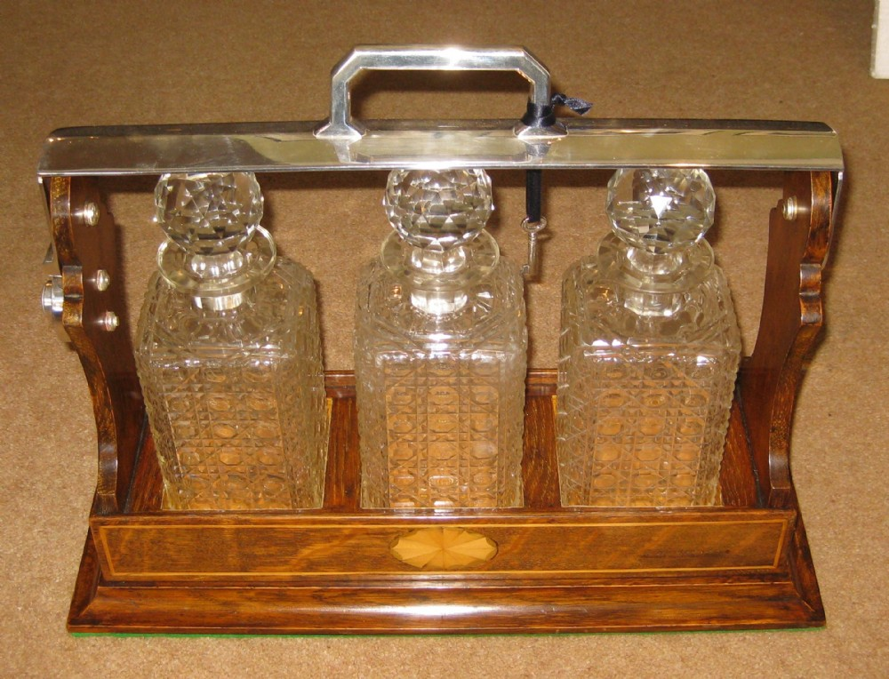 a lovely late victorian oak inlaid tantalus