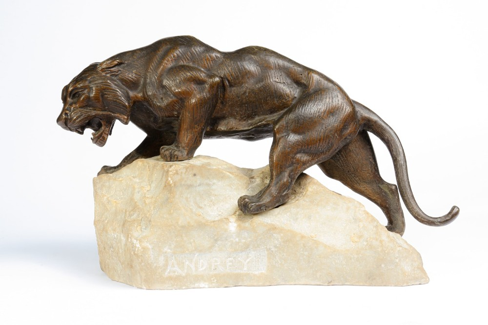 bronze tiger on a rock by james andrey france c1920