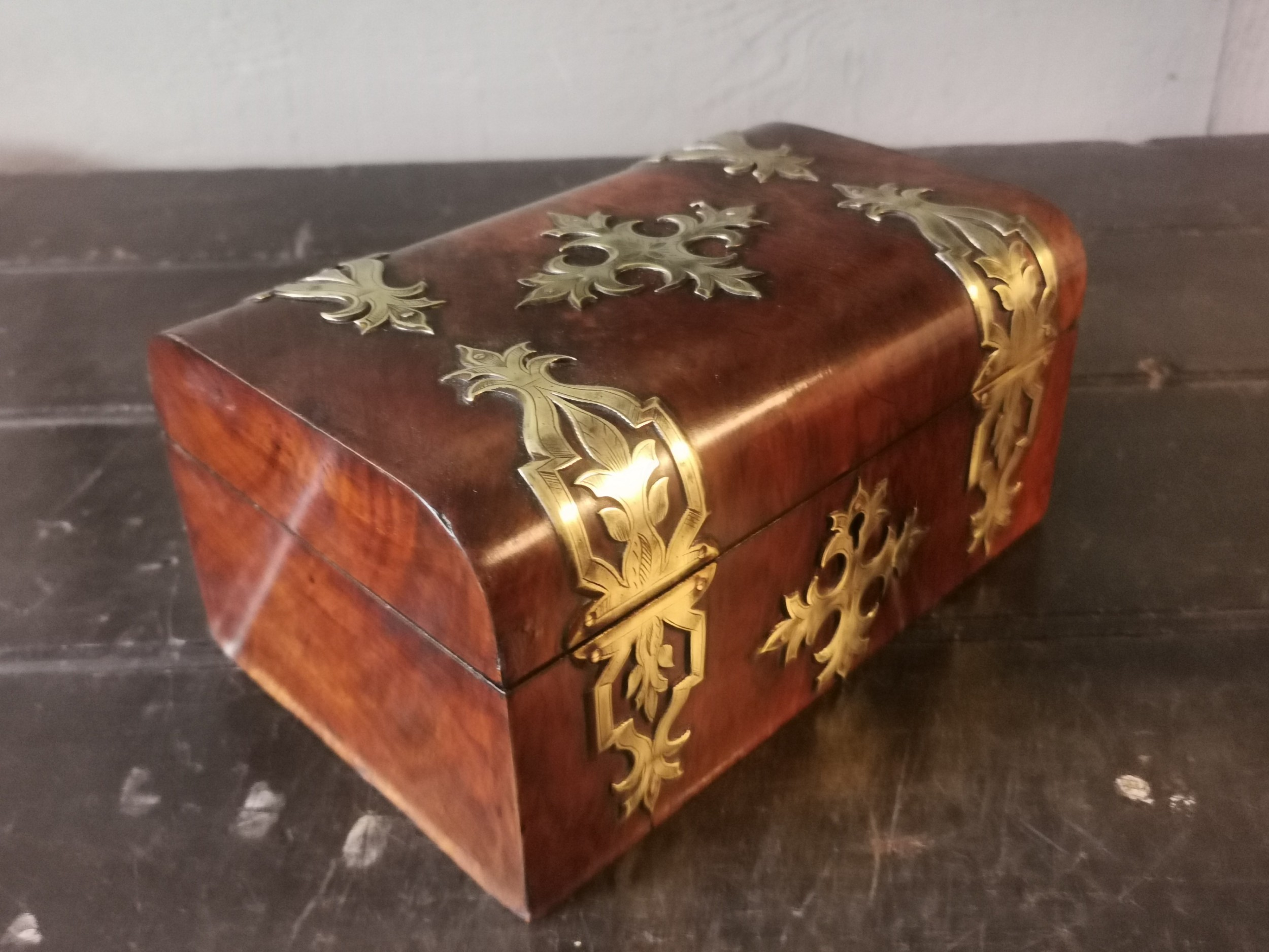 an antique walnut brass bound domed box