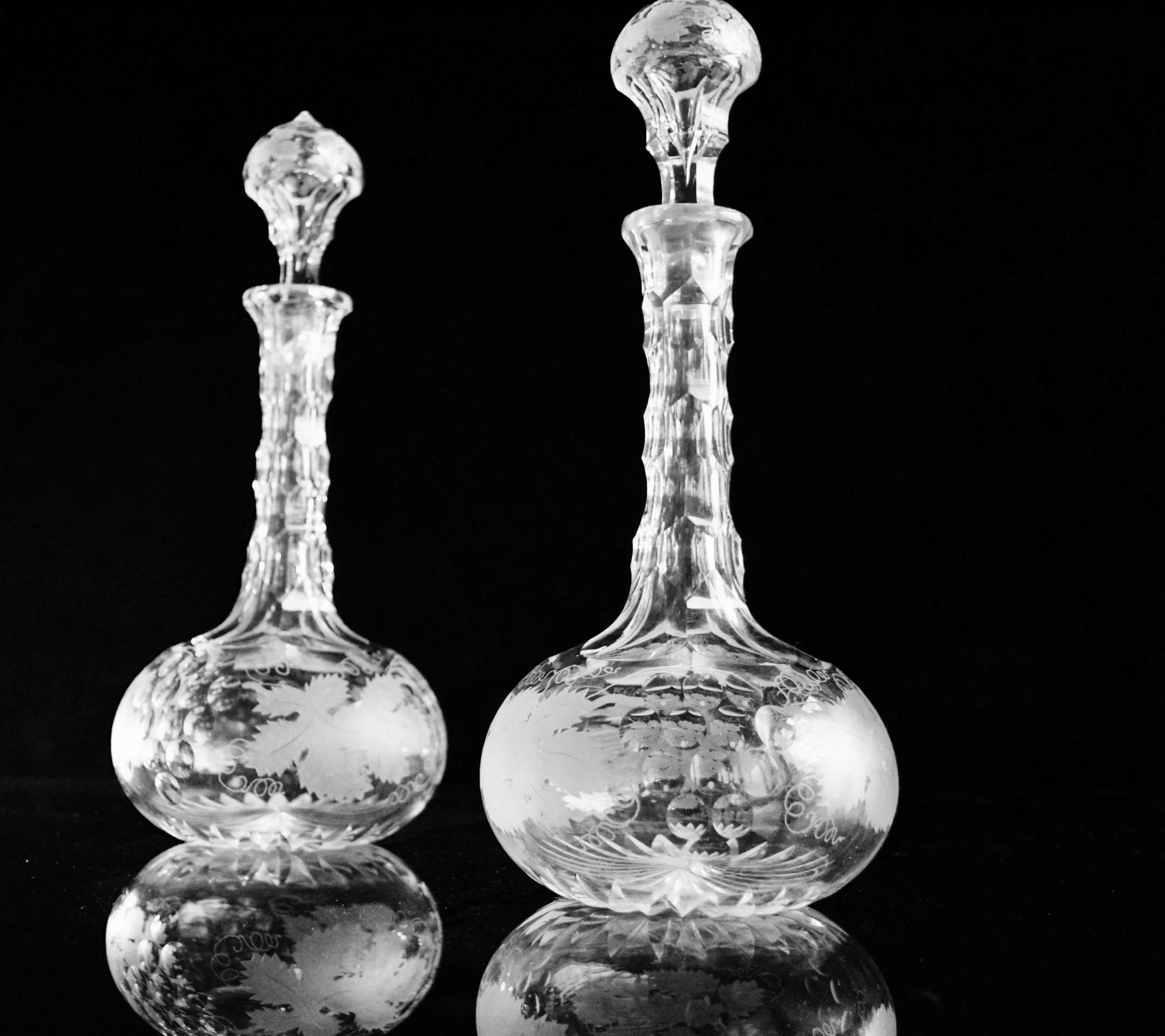 pair of edwardian fruiting vine port decanters intaglio cut