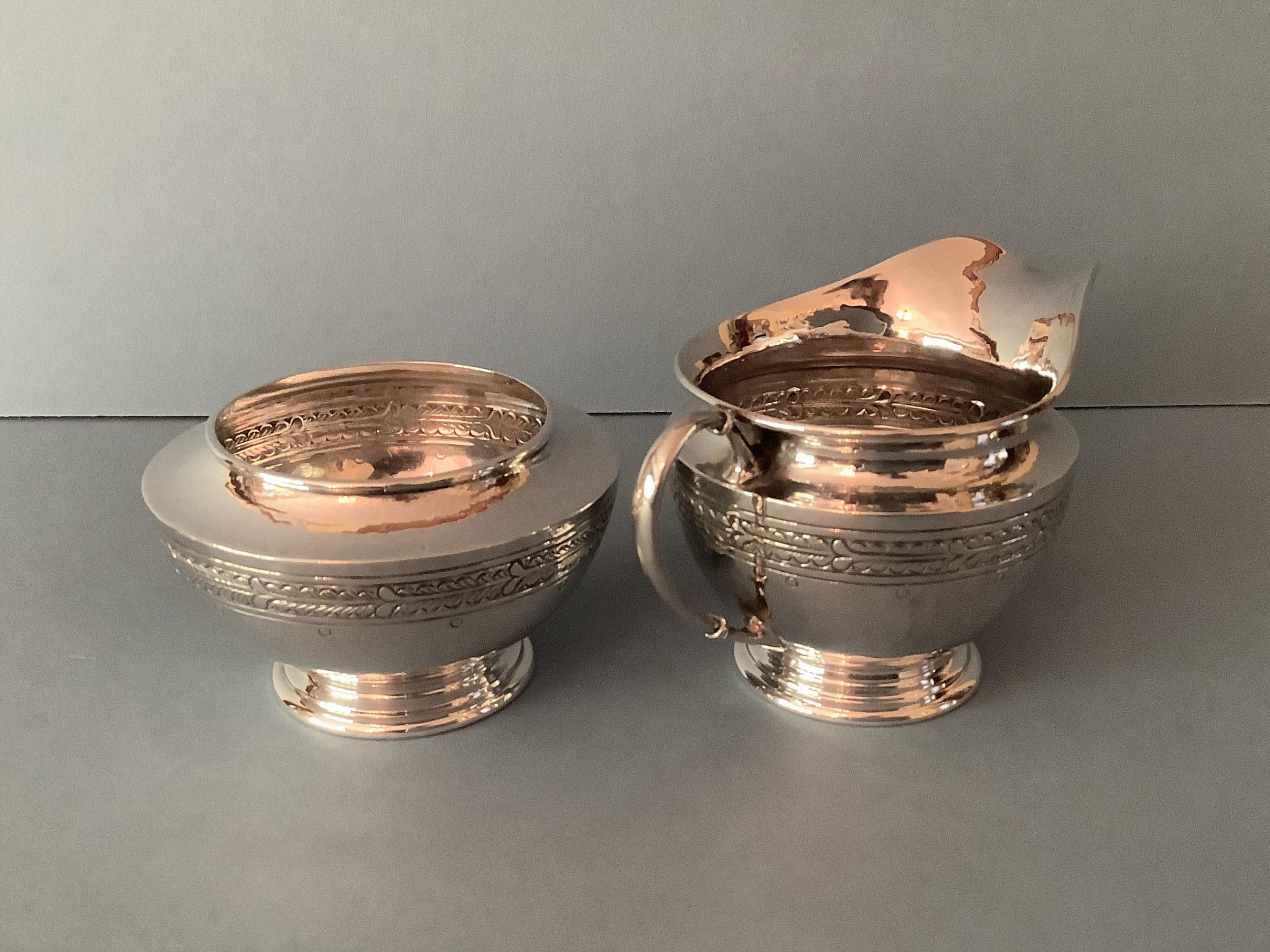 antique silver liberty milk jug and sugar bowl