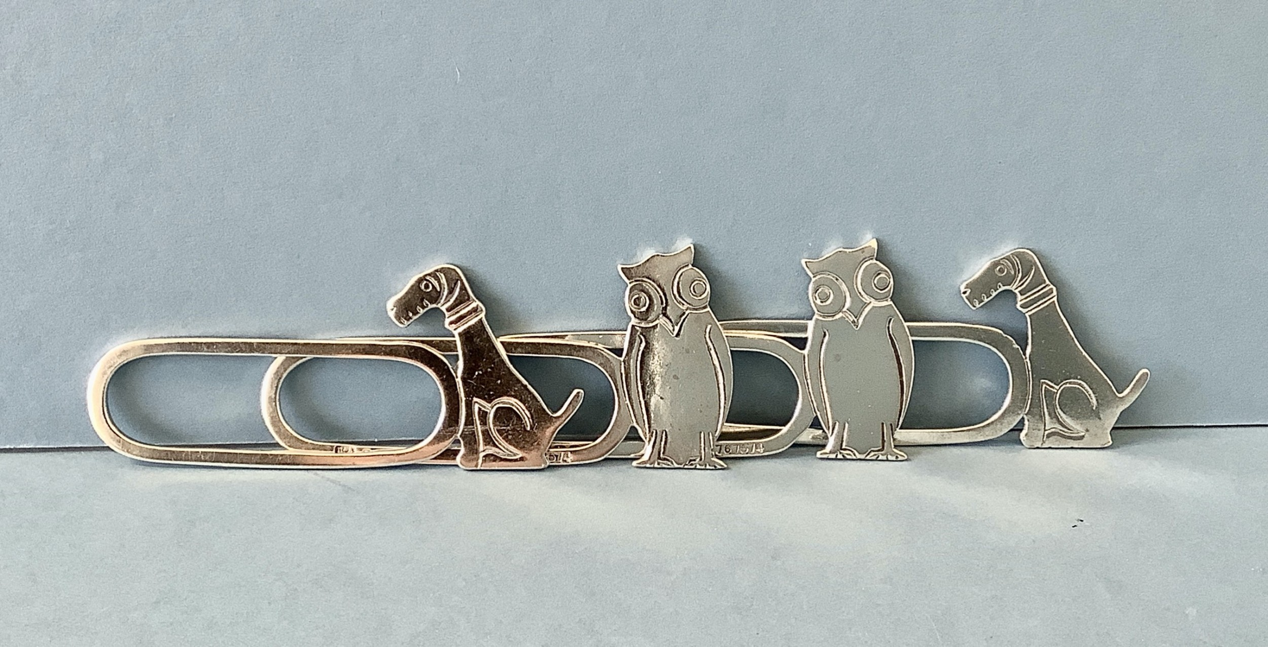 set of 4 solid silver novelty napkin rings