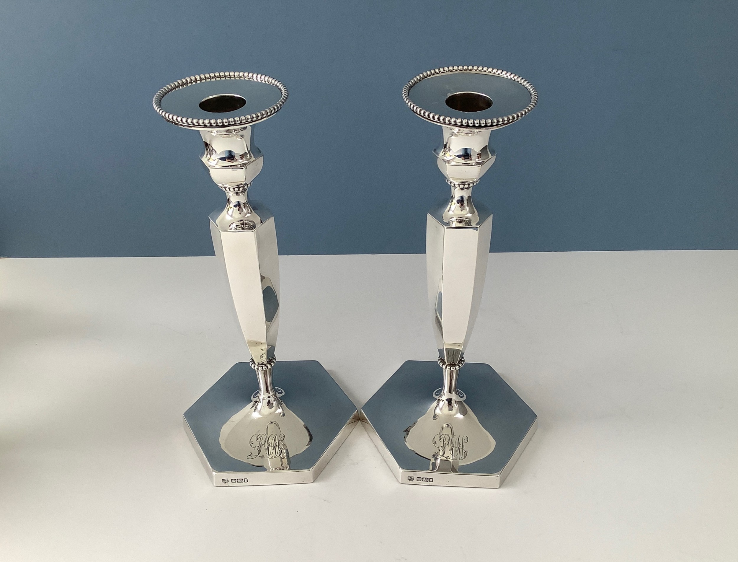 elegant pair of edwardian silver candlesticks