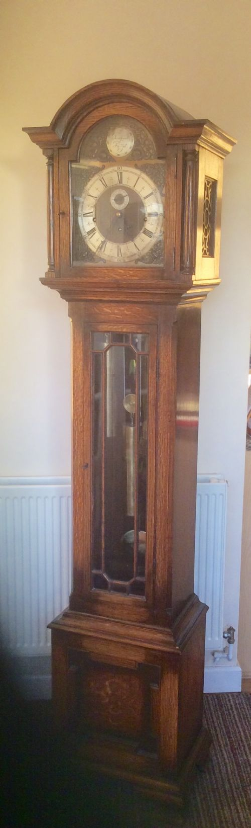top quality glass fronted cable driven triple weight westminster chiming oak cased grandfather longcase clock with seconds chapter ring