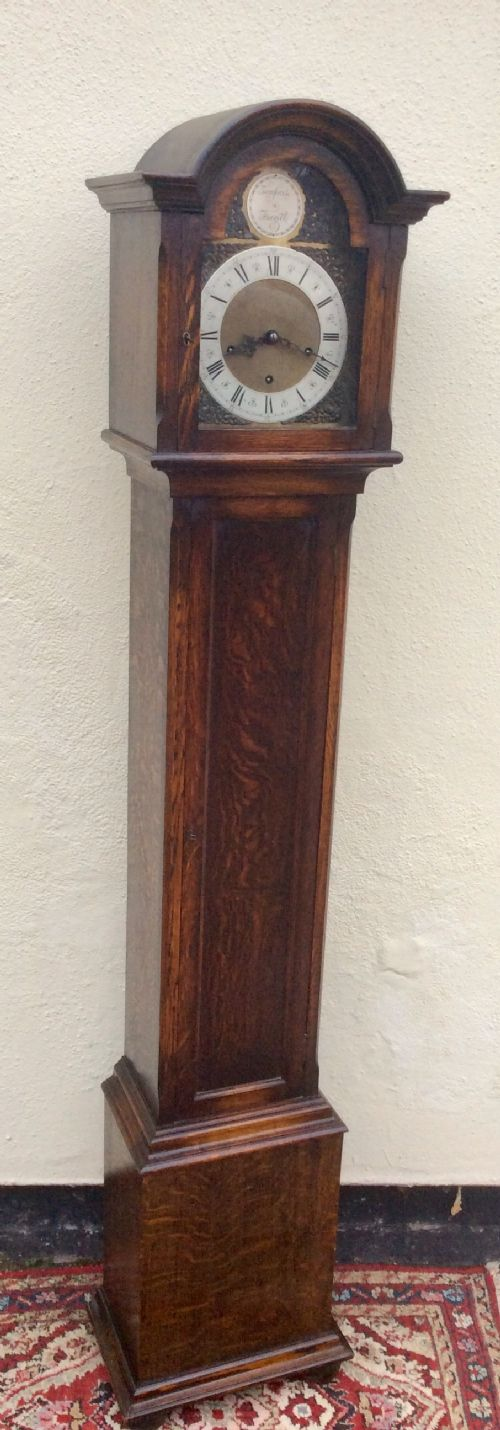 westminster chiming oak cased grandmother or small grandfather longcase clock