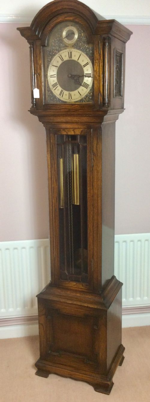 mellow sounding triple tune triple weight glass door oak grandfather longcase clock
