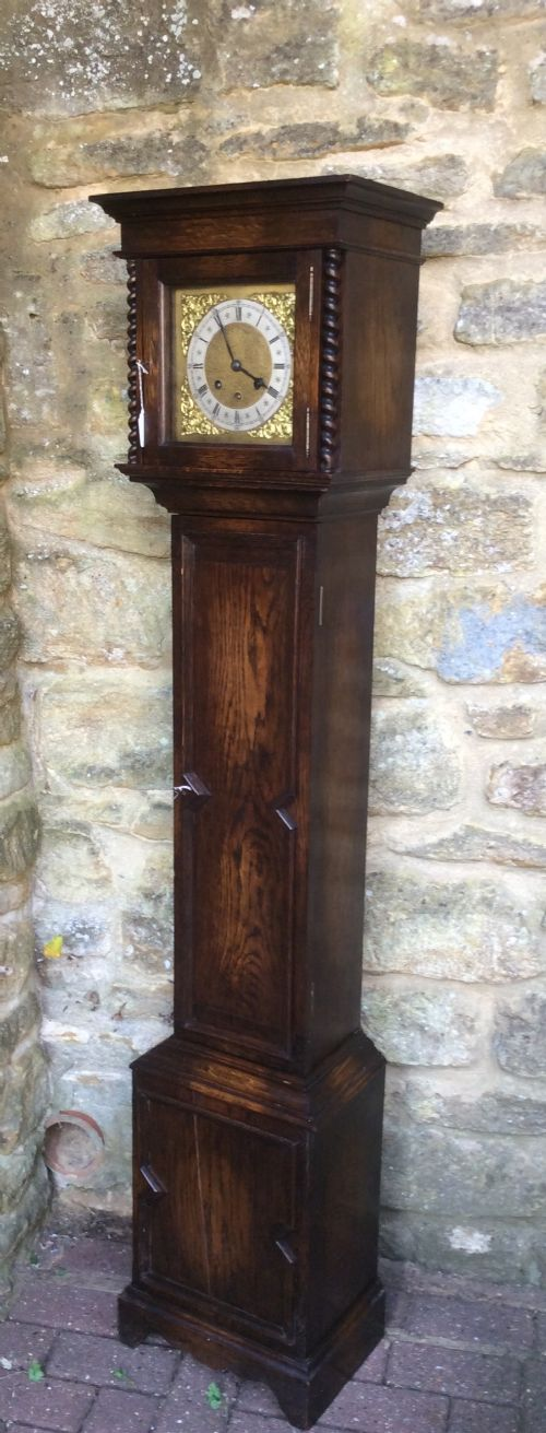 charming small oak grandfather or grandmother longcase clock with barley twist columns playing westminster chimes