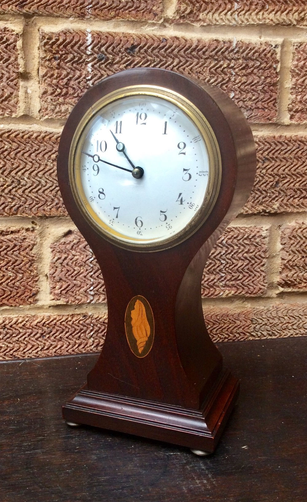 solid mahogany balloon shaped french 8 day timepiece clock with conk shell paterae decoration