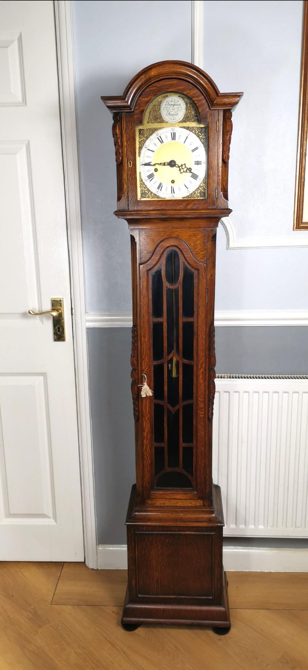 quarter chiming hour striking english dwarf grandfather or grandmother musical longcase clock of good warm oak astagal glazed trunk door on bun feet