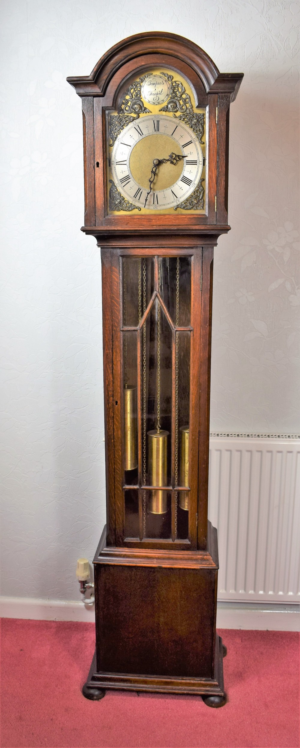 astragal glazed triple weight oak grandmother or grandfather longcase clock with good quality embee 8 day movement playing mellow westminster musical chimes on each quarter
