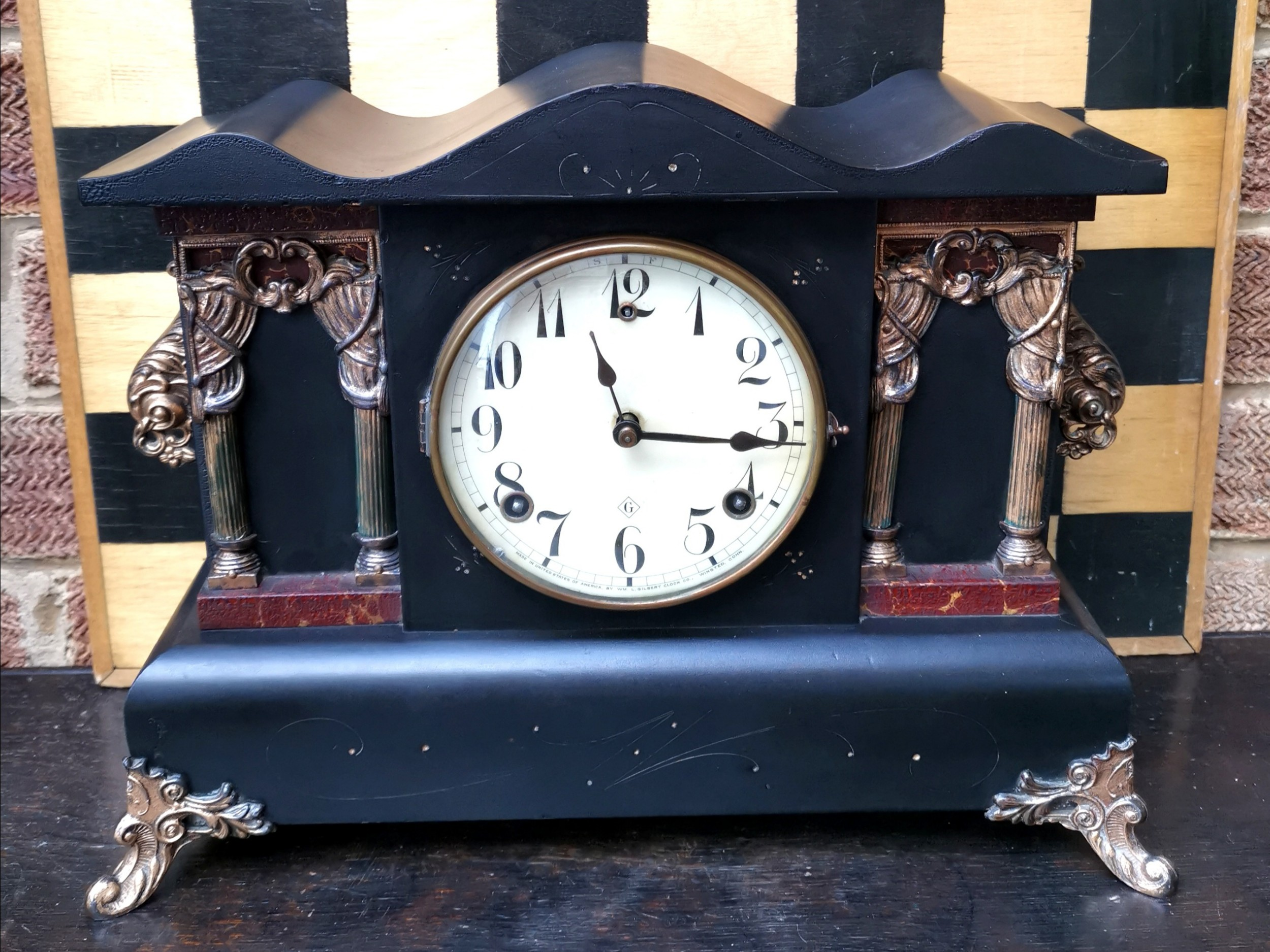 wm gilbert usa ebonised serpentine gilt coloured 8 day bell chiming and gong striking late 19thearly 20th c mantle clock