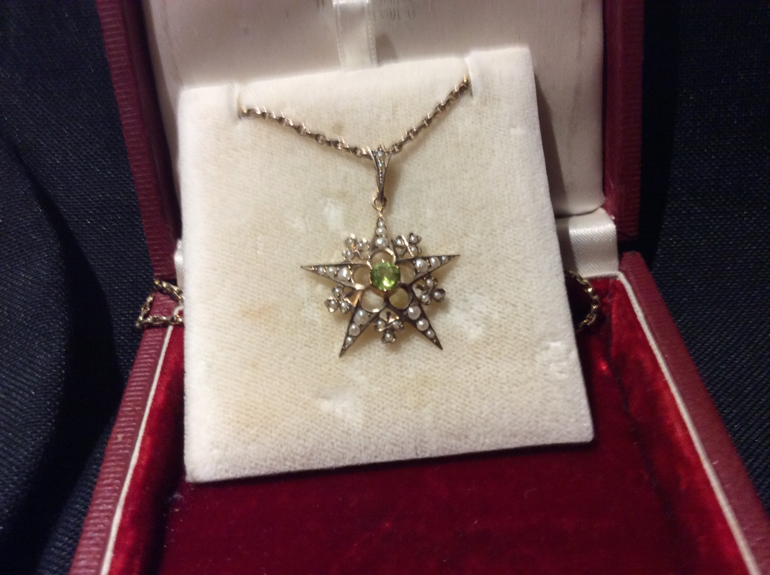 star shaped gold pendant with gold chain