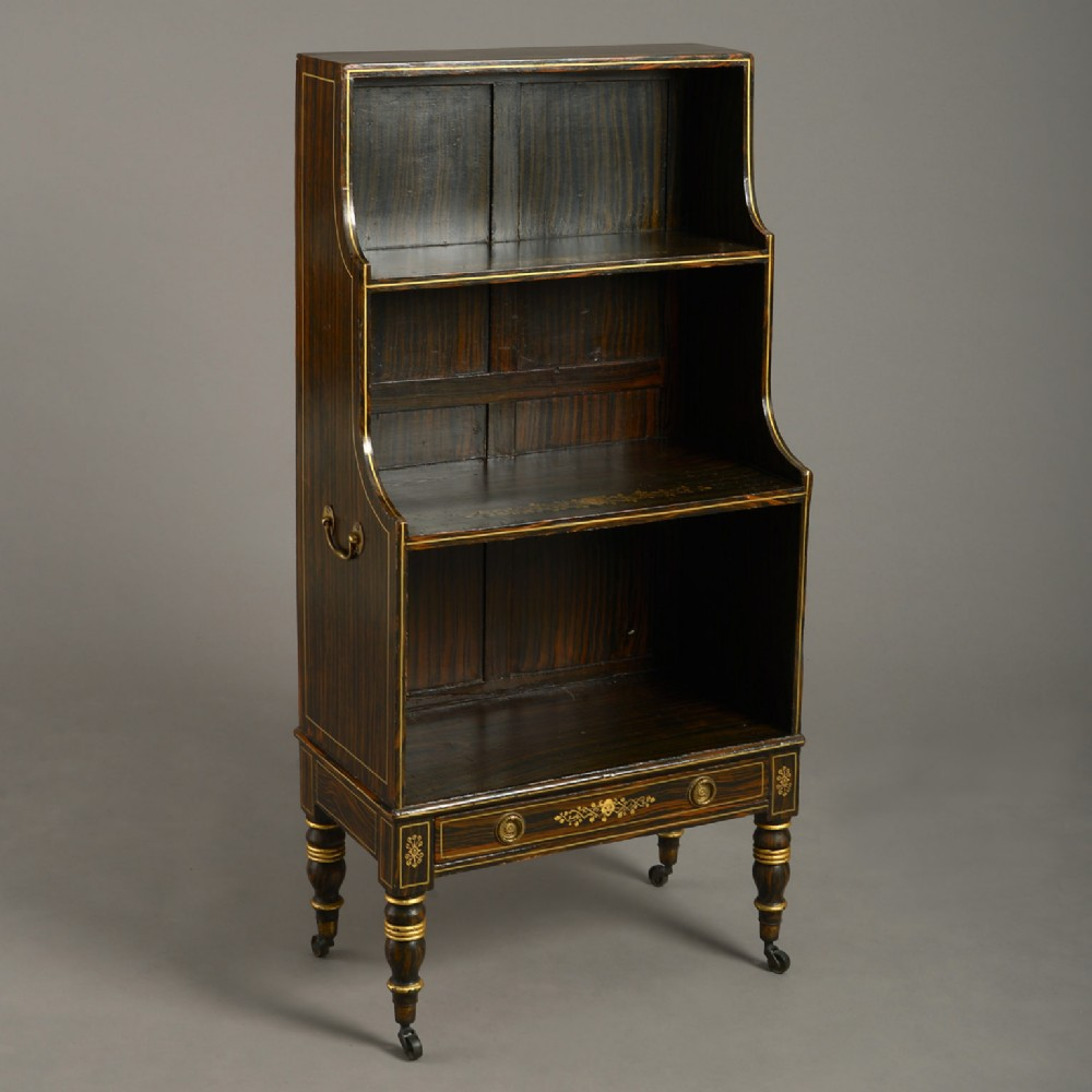an early 19th century regency period faux rosewood waterfall bookcase