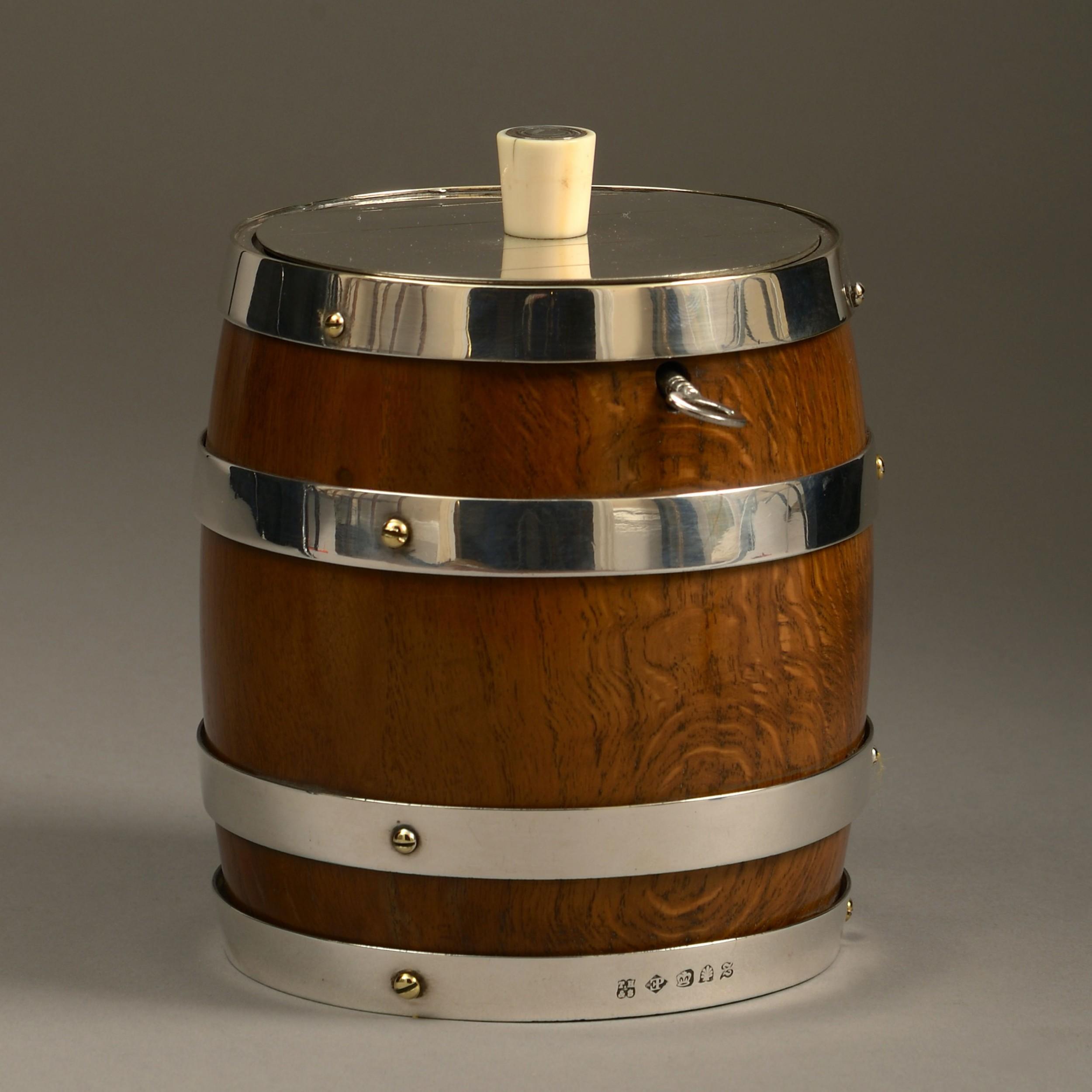 a 19th century oak and silvered barrel tobacco jar