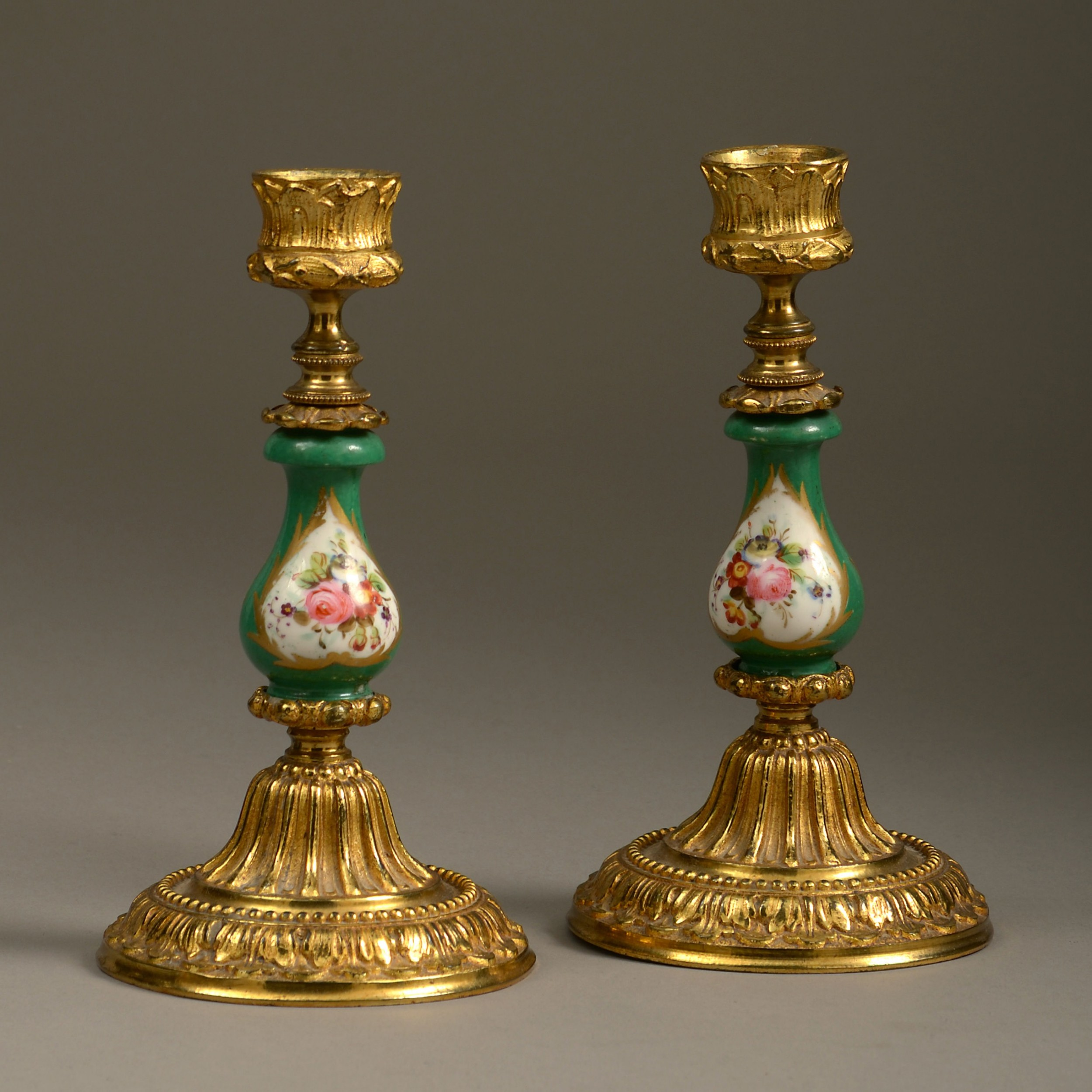 a 19th century pair of sevres and ormolu candlesticks