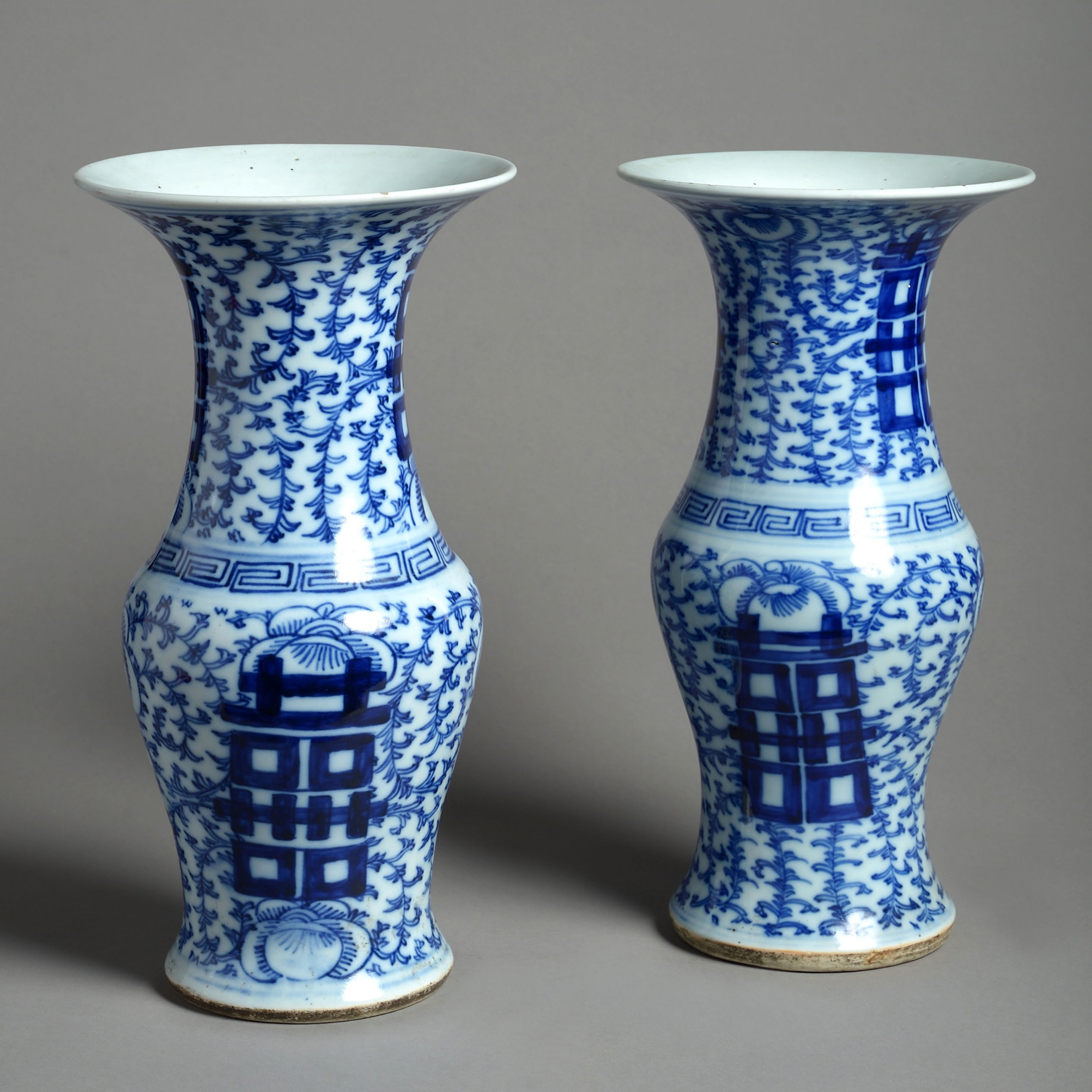 a 19th century pair of blue and white porcelain trumpet vases