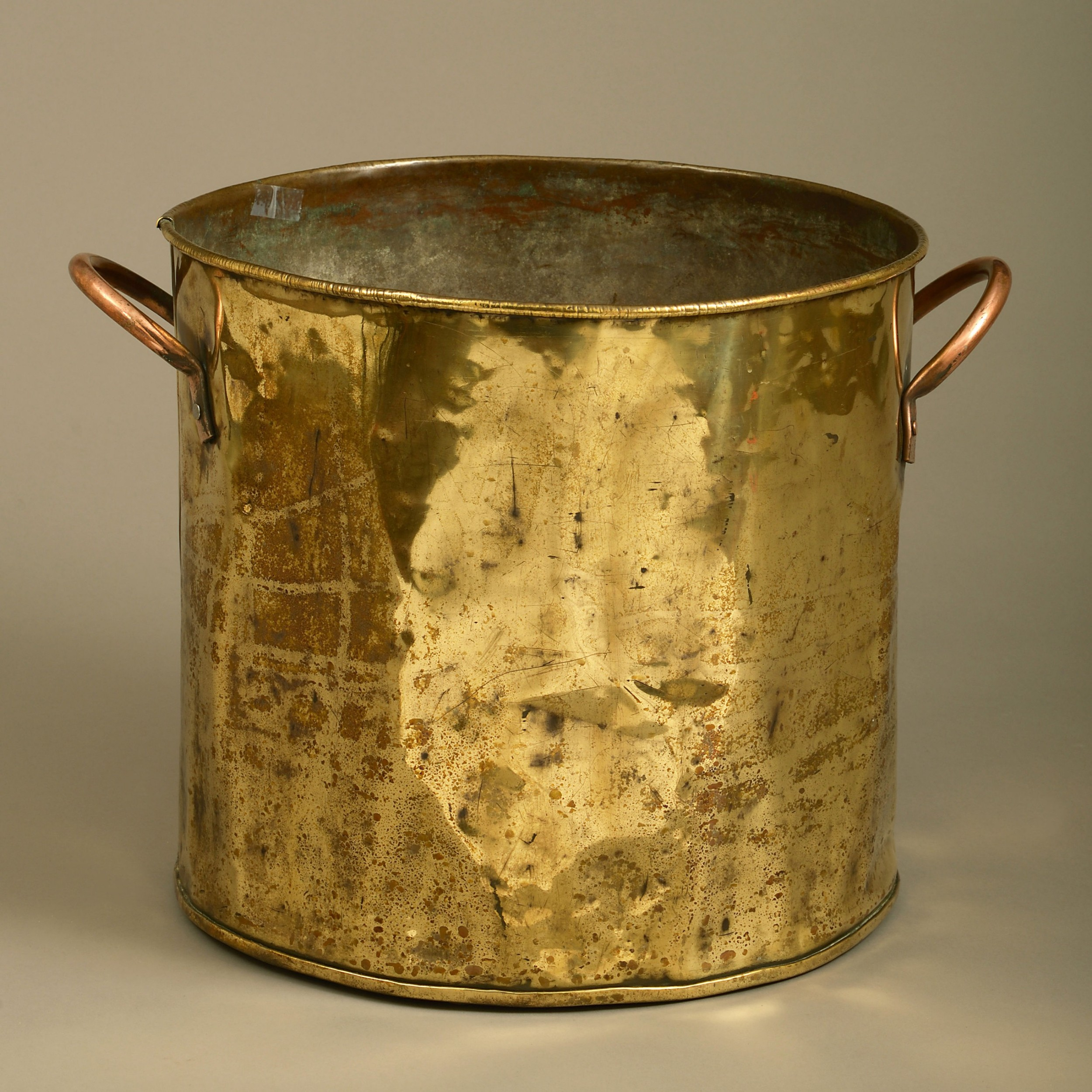 a late 19th century brass and copper log bin