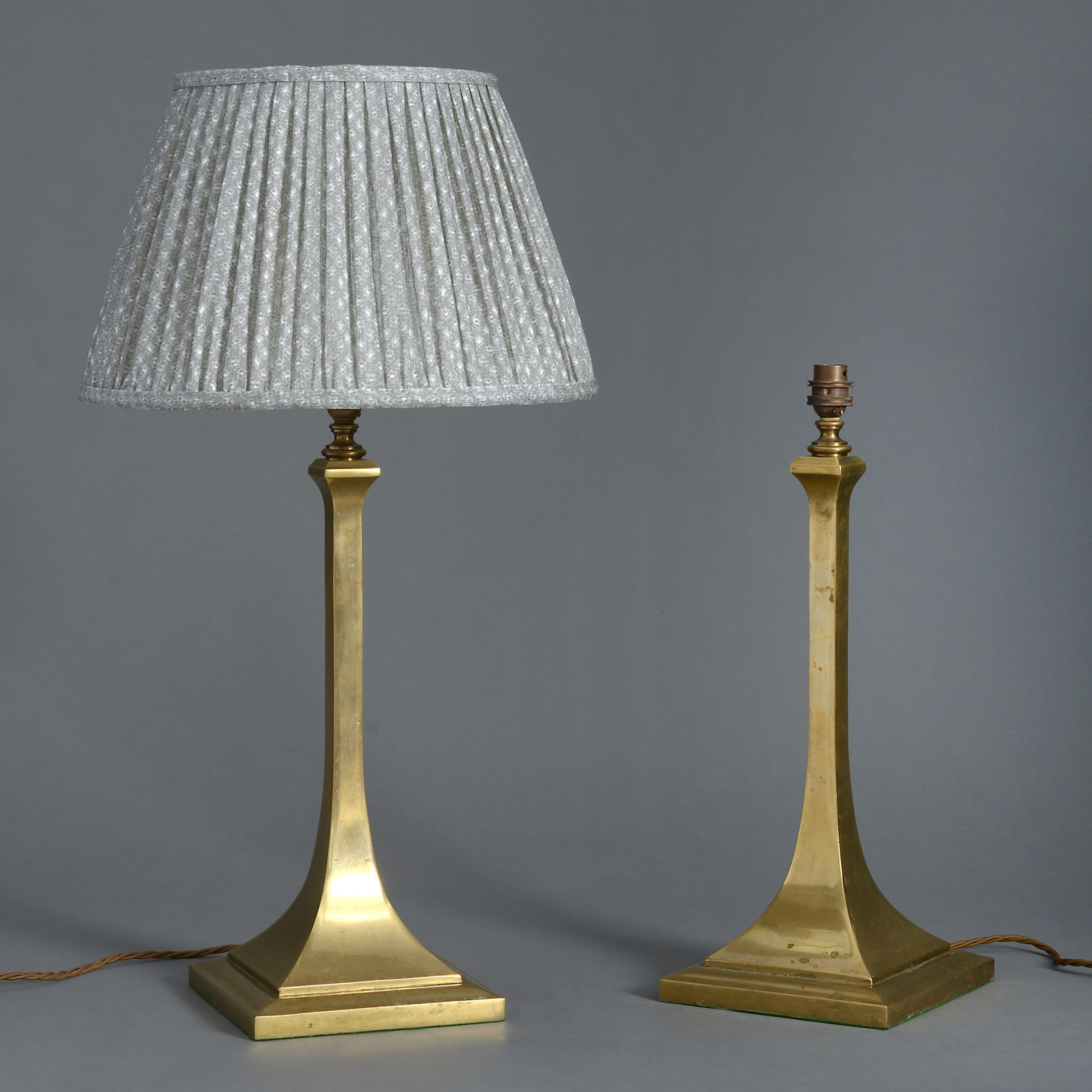 a pair of edwardian brass table lamps