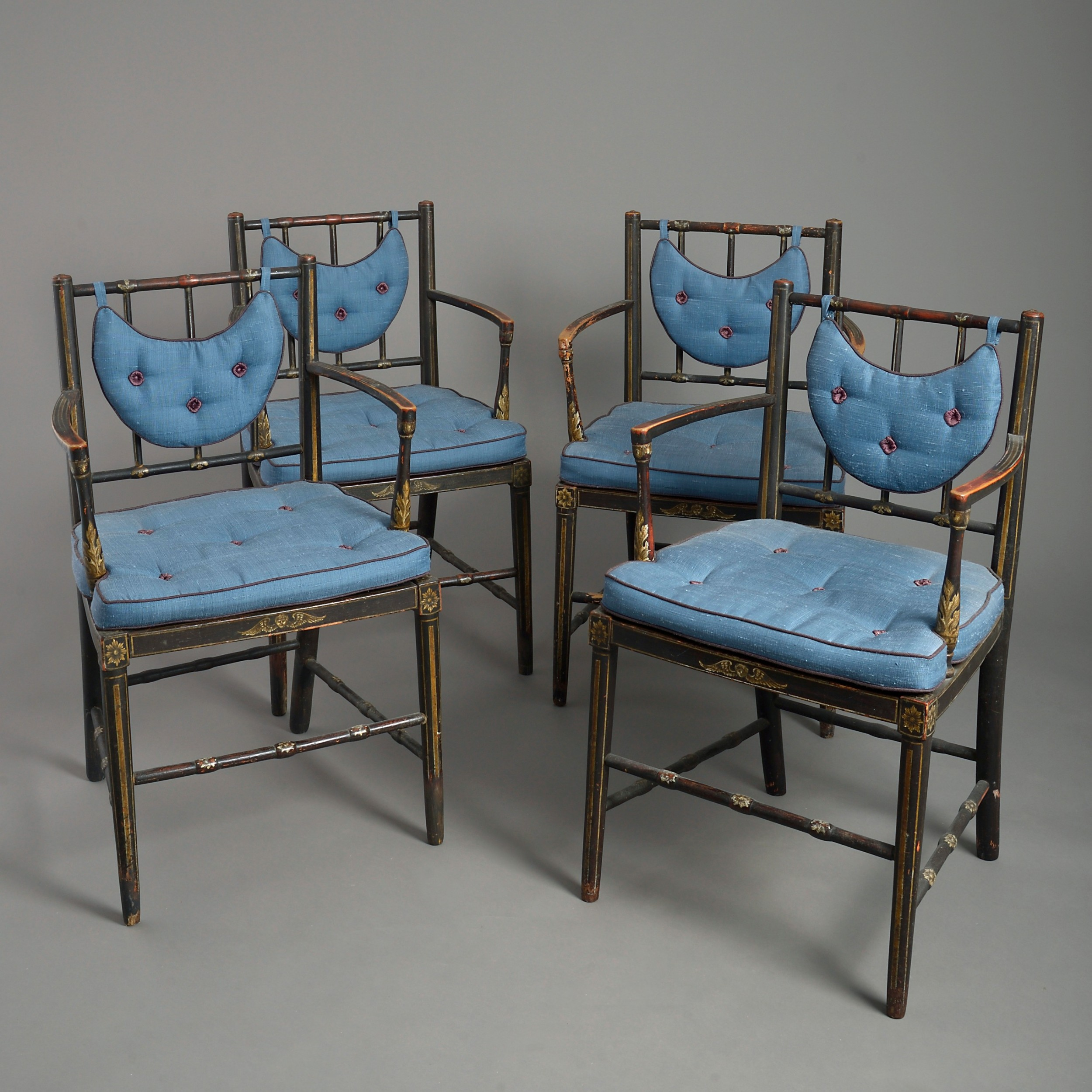 four early nineteenth century regency period armchairs