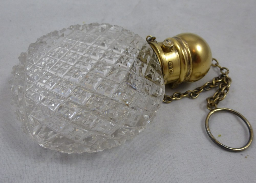 an extremely fine midlate victorian silver gilt and cut glass perfume bottle by george brace of london