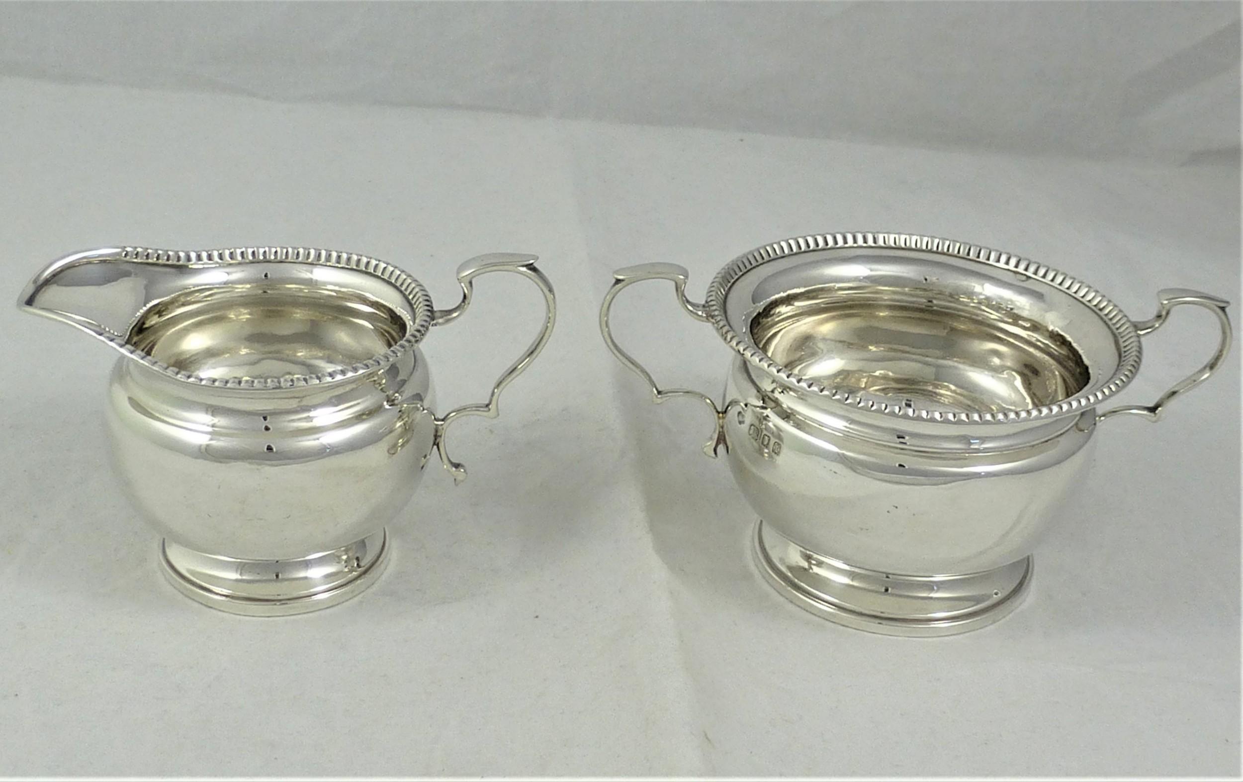 goldsmiths silversmiths silver milk jug and sugar bowl