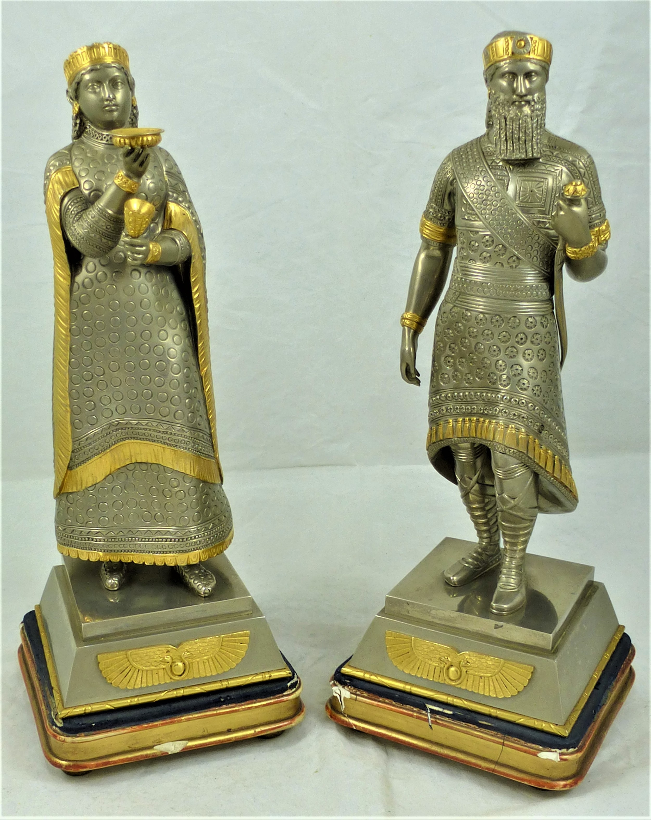 pair of figures of assyrian king sardanapalus and queen