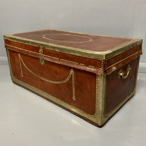 unusual red leather and brass bound camphor trunk chest