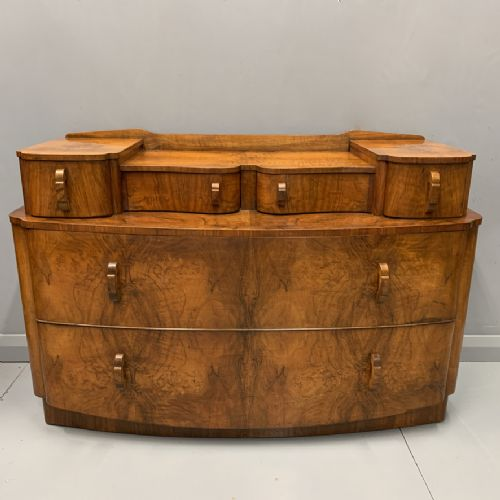 art deco bow front chest in figured walnut