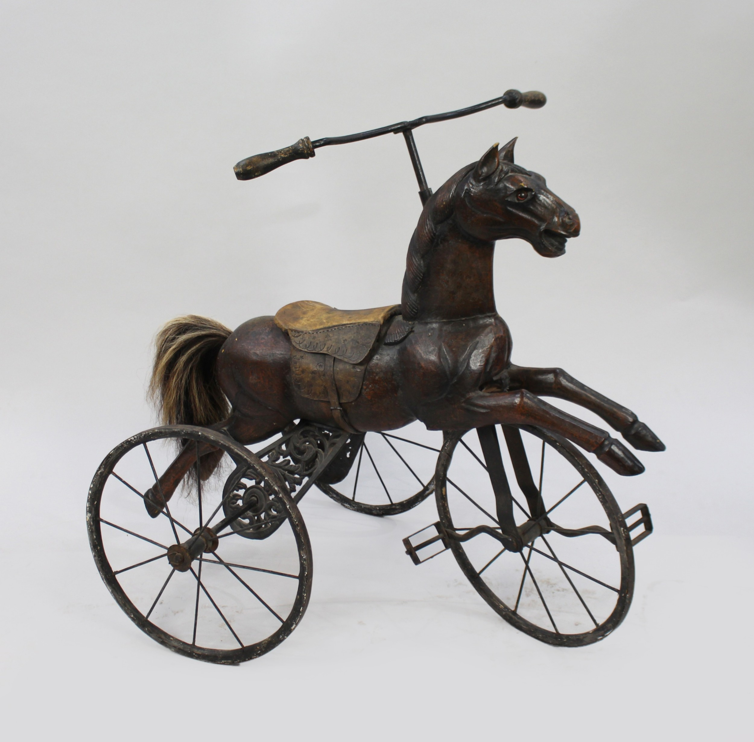 early 20th c carved wooden toy horse tricycle