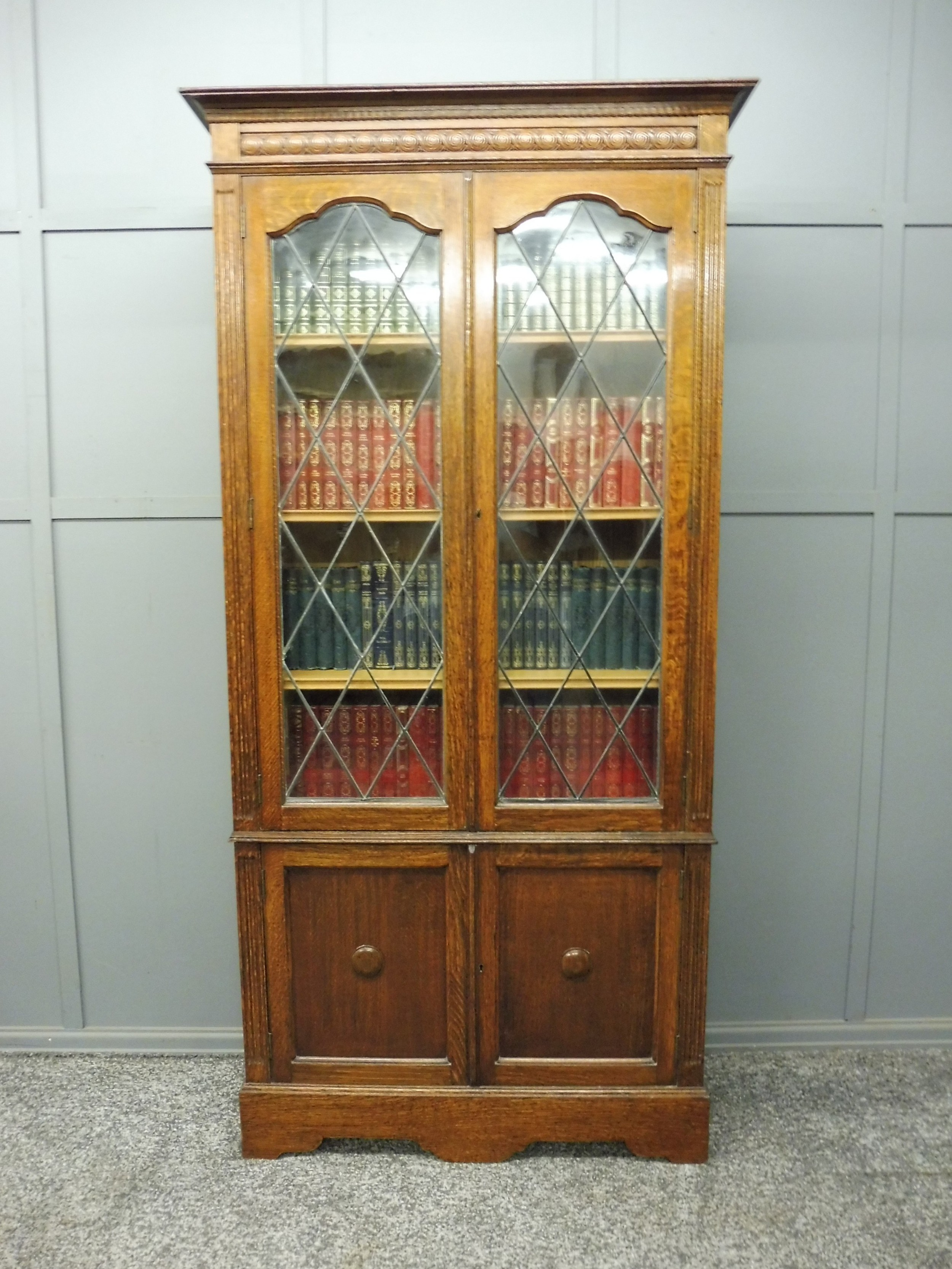 Oak Bookcase With Leaded Glass Doors 639284