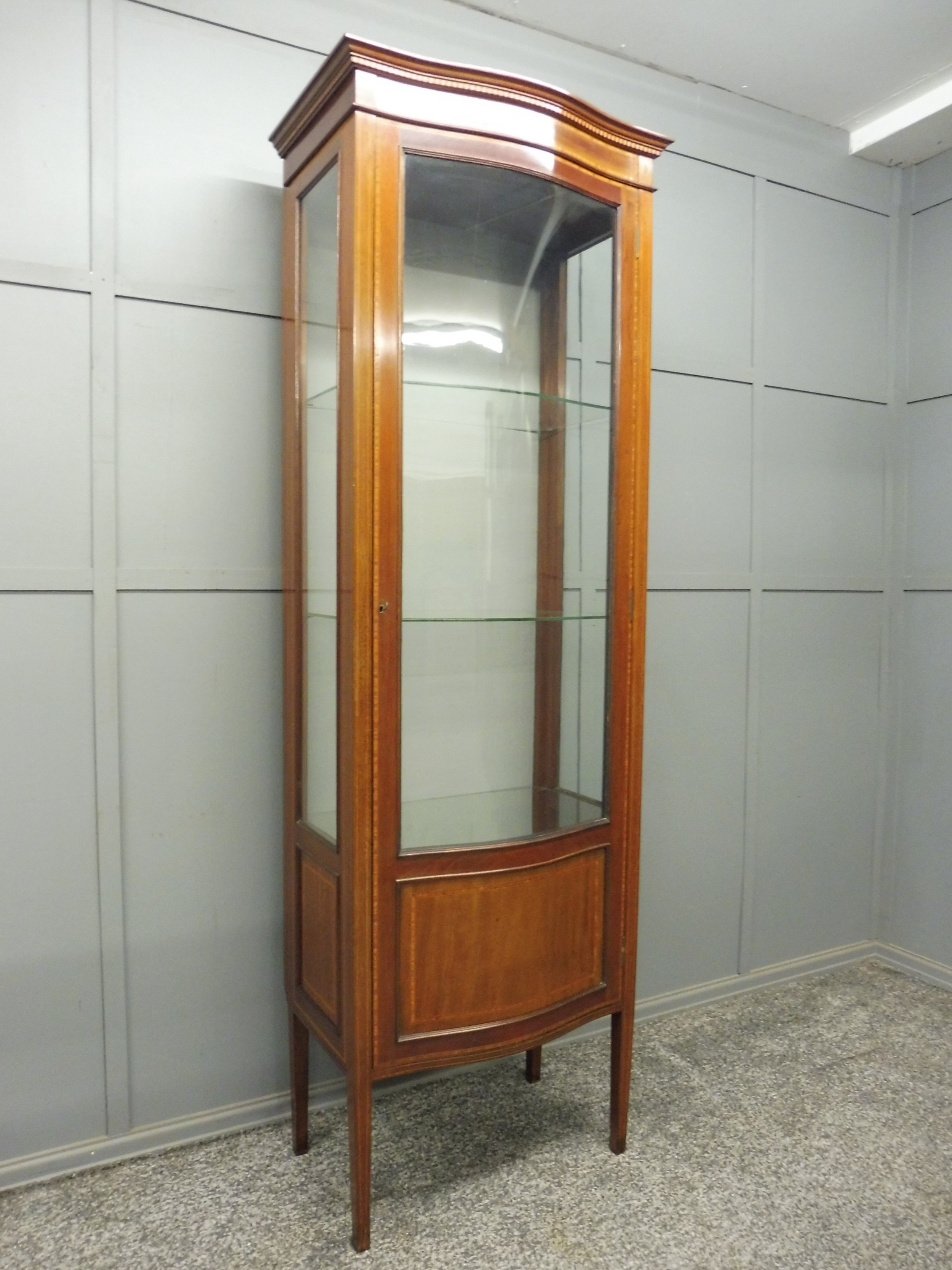 tall slim serpentine fronted edwardian inlaid display cabinet circa 19001910